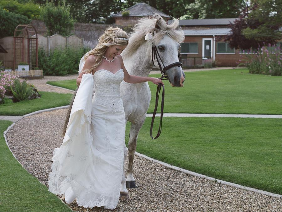 Orangery Wimborne Wedding Photographer and bride with horse