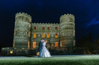 Lulworth Castle Dorset Wedding Photographer at night with bride and groom