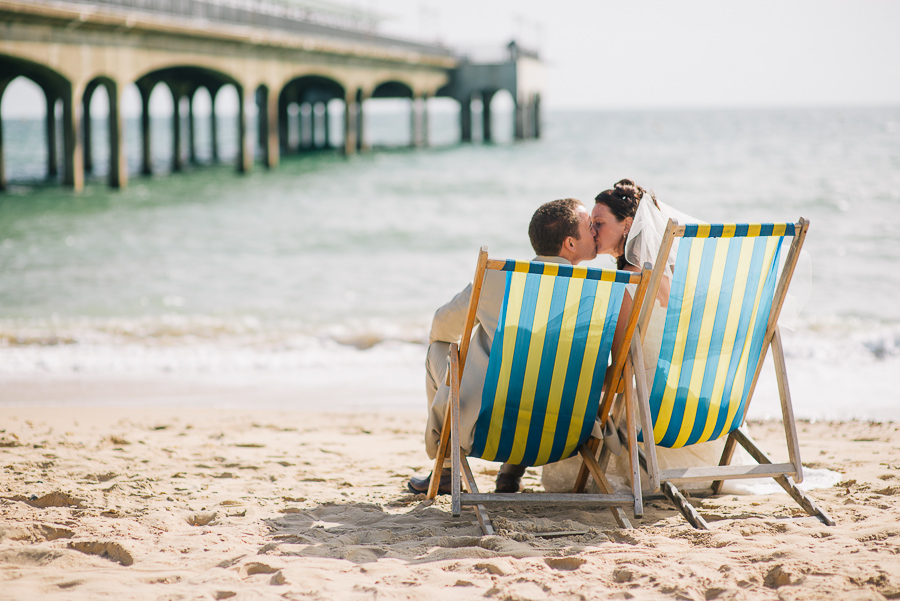 bournemouth beach wedding photography bride and group in deckchairs