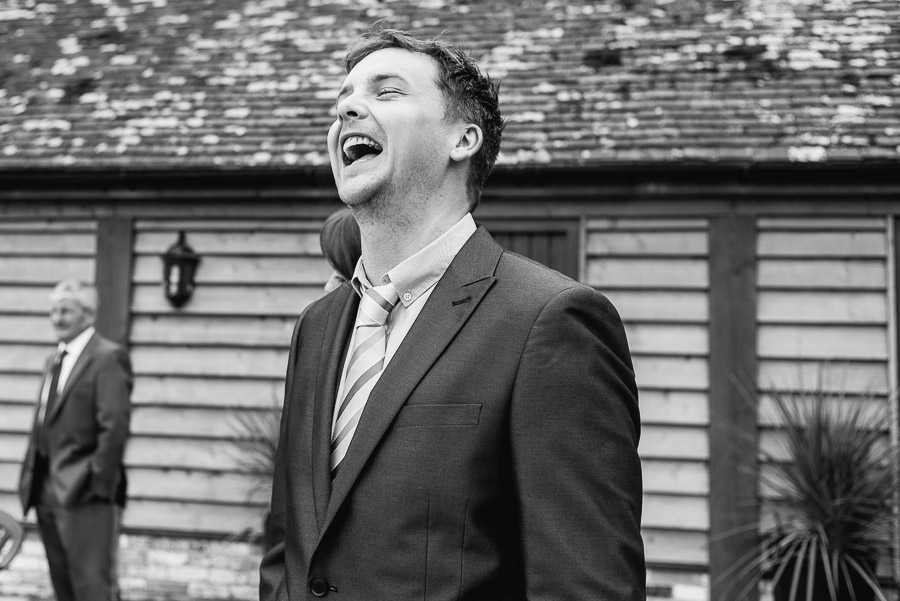 kingston country courtyard wedding guest laughing