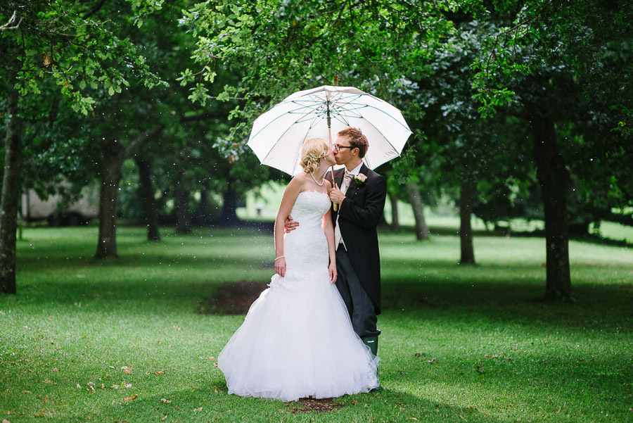 Wet and rainy Kingston maurward wedding photography bride and groom