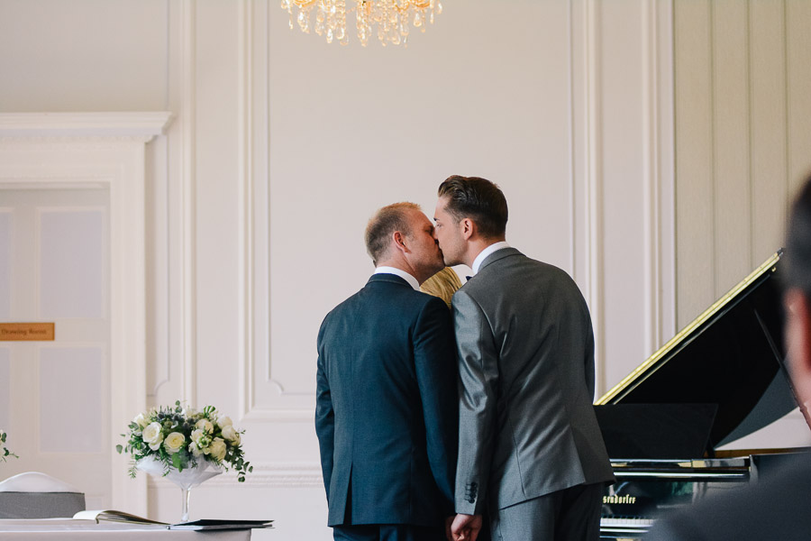 wedding at merley house in wimborne dorset grooms kissing