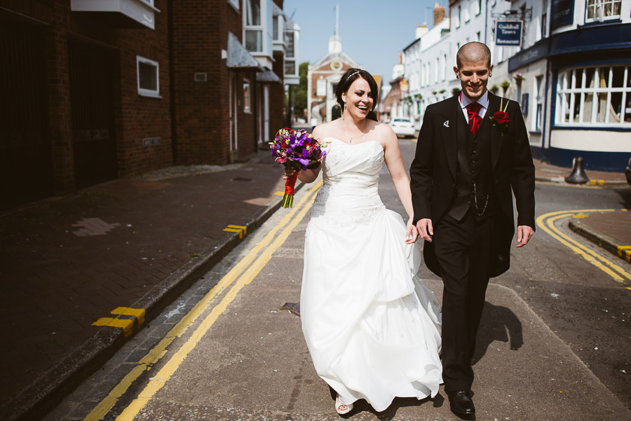 Bride and groom walking away from poole guildhall wedding photography