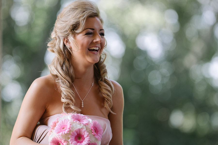 canford school bournemouth wedding photographer - laughing bridesmaid