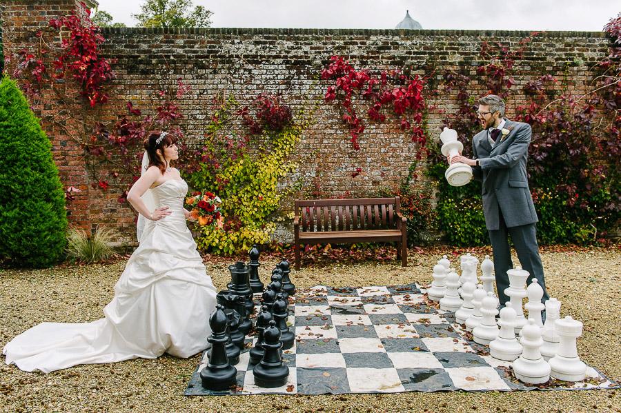checkmate at autumnal wedding at orangery wimborne