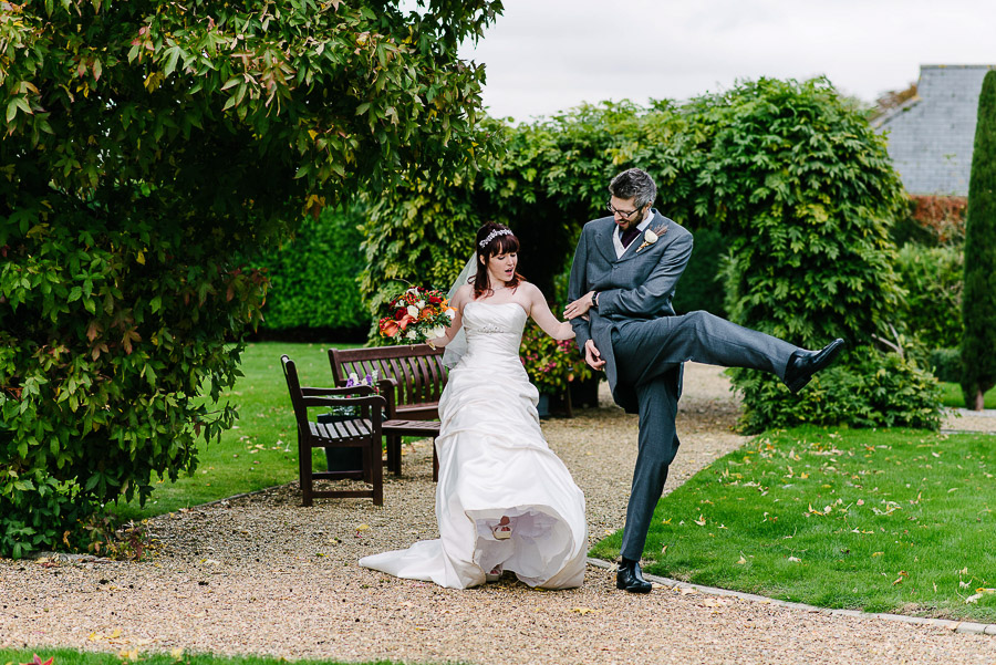 high kicks at autumnal wedding at orangery wimborne