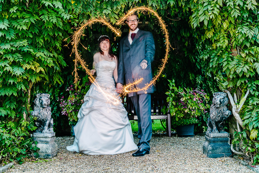 sparklers at autumnal wedding at orangery wimborne