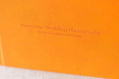 tangerine cover on the leather bound fine art album