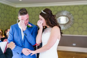 emotional wedding ceremony with both bride and groom getting emotional at the green house hotel